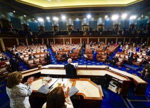 Picture from behind the congressional dais, facing Joe Biden addressing Congress