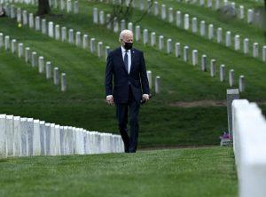 Biden walking through Arlington Cemetery