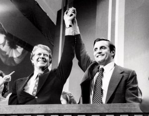 President Jimmy Carter and VP Walter Mondale with arms in the air as a sign of victory