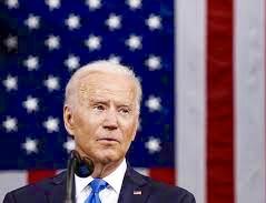Joe Biden with American flag behind him