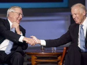 Walter Mondale and Joe Biden shaking hands in 2015